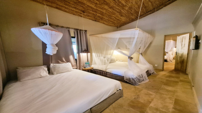 Two double beds in a family bungalow at Hotel Les Palétuviers